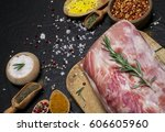 raw meat. raw pork meat on a... | Shutterstock . vector #606605960