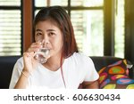 asia woman drinking glass of... | Shutterstock . vector #606630434