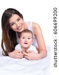 happy young mother tenderly... | Shutterstock . vector #606699200