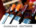 bottles of wine shot with... | Shutterstock . vector #606706808