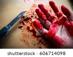 Bloody Woman Hand And Knife On...