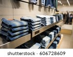 stack of blue jeans in a shop. | Shutterstock . vector #606728609
