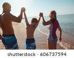 happy family hold hands and run ... | Shutterstock . vector #606737594