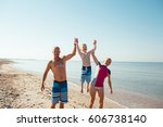 happy family hold hands and run ... | Shutterstock . vector #606738140