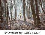 runner is running through misty ...   Shutterstock . vector #606741374