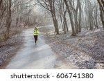 runner is running through misty ...   Shutterstock . vector #606741380