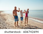 happy family hold hands and run ... | Shutterstock . vector #606742694
