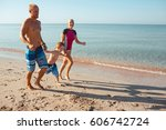 happy family hold hands and run ... | Shutterstock . vector #606742724