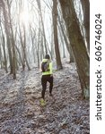 runner is running through misty ...   Shutterstock . vector #606746024