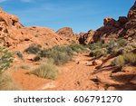 hiking trail surrounded by red... | Shutterstock . vector #606791270
