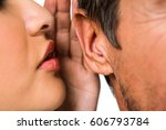 close up of woman whispering in ... | Shutterstock . vector #606793784
