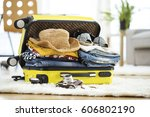 preparation travel suitcase at... | Shutterstock . vector #606802190