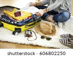 preparation travel suitcase at... | Shutterstock . vector #606802250