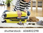 preparation travel suitcase at... | Shutterstock . vector #606802298