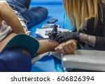 a tattoo artist is designing a... | Shutterstock . vector #606826394