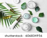 natural cosmetics and leaves on ... | Shutterstock . vector #606834956