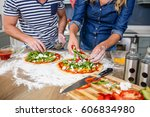 smiling couple preparing pizza... | Shutterstock . vector #606834980