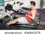 muscular man on rowing machine... | Shutterstock . vector #606841079