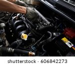 the mechanic is repairing the... | Shutterstock . vector #606842273