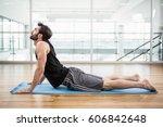 handsome man on cobra pose on... | Shutterstock . vector #606842648