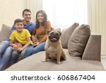 close up of a boy with pug and... | Shutterstock . vector #606867404