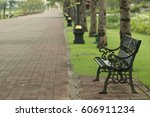 a lonely chair in the park is...   Shutterstock . vector #606911234