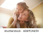 mother and daughter having fun... | Shutterstock . vector #606914654