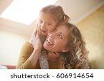 mother and daughter having fun... | Shutterstock . vector #606914654