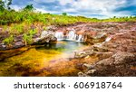 multicolored waterfall river in ... | Shutterstock . vector #606918764