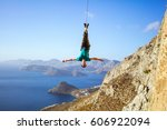 cheerful rock climber swinging... | Shutterstock . vector #606922094