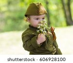 Boy In Military Uniform On...