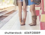 young women standing at railway ... | Shutterstock . vector #606928889