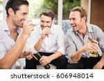 group of men smoking and... | Shutterstock . vector #606948014