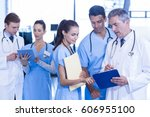 medical team discussing... | Shutterstock . vector #606955100