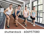 four athletic women and men... | Shutterstock . vector #606957080