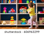 toddler playing with her toys. | Shutterstock . vector #606963299
