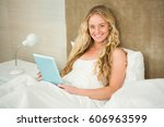 pretty woman using tablet... | Shutterstock . vector #606963599