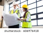 architects looking at blueprint ... | Shutterstock . vector #606976418