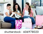 three women sitting on sofa and ... | Shutterstock . vector #606978020