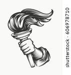 human hand holds a torch....   Shutterstock .eps vector #606978710