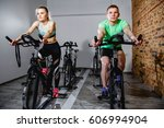 young man and woman biking in...   Shutterstock . vector #606994904
