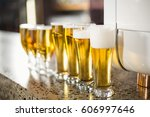 lined up beers on table in bar | Shutterstock . vector #606997646