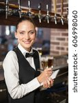 barmaid taking orders on... | Shutterstock . vector #606998060