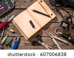 accessories for fishing on the... | Shutterstock . vector #607006838