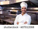 portrait of handsome chef in a... | Shutterstock . vector #607012088