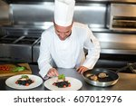 handsome chef putting finishing ... | Shutterstock . vector #607012976