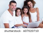 portrait of family using laptop ... | Shutterstock . vector #607020710