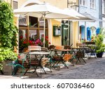 table and chairs at a sidewalk... | Shutterstock . vector #607036460