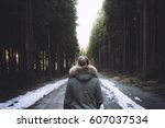 young woman walking away on a... | Shutterstock . vector #607037534