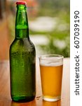 bottle and glass of beer on a... | Shutterstock . vector #607039190